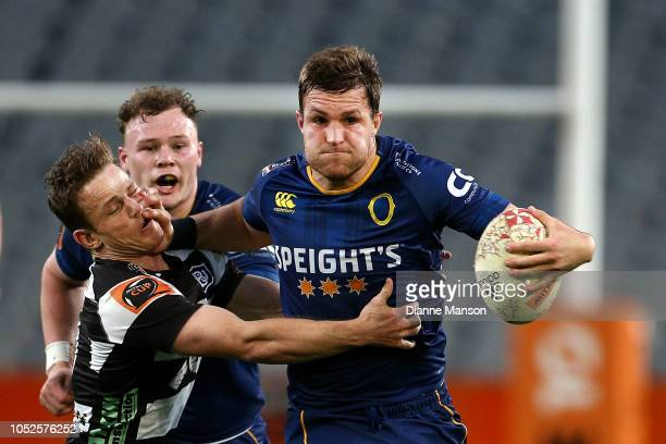 Michael Collins of Otago fends of Brad Weber of Hawkes Bay during the Mitre 10 Cup Championship Semi Final match between Otago and Hawke's Bay on...