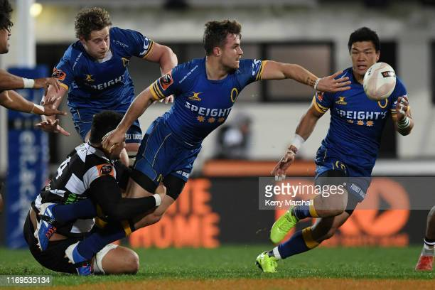 Michael Collins of Otago gets a pass away during the round three Mitre 10 Cup match between Hawke's Bay and Otago at McLean Park on August 22, 2019...