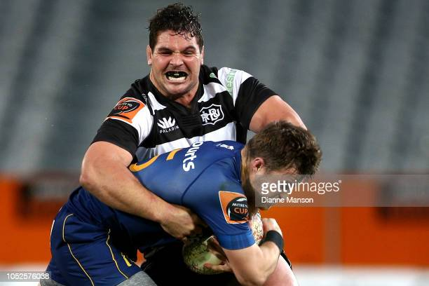 Michael Collins of Otago is tackled by Ben May of Hawkes Bay during the Mitre 10 Cup Championship Semi Final match between Otago and Hawke's Bay on...