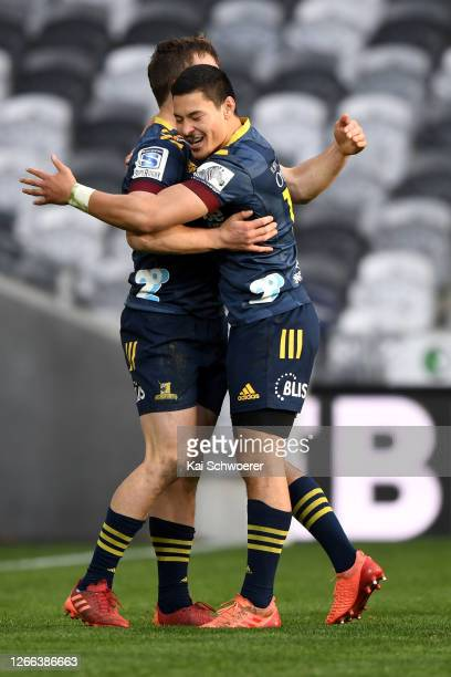 Michael Collins of the Highlanders celebrates with Patelesio Tomkinson of the Highlanders after scoring a try during the round 10 Super Rugby...