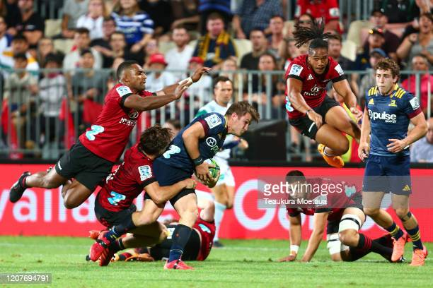 Michael Collins of the Highlanders is tackled during the round four Super Rugby match between the Crusaders and Highlanders at Orangetheory Stadium...