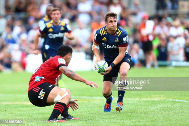 Michael Collins of the Highlanders looks to pass during the Super Rugby pre-season match between the Highlanders and the Crusaders at Wanaka...