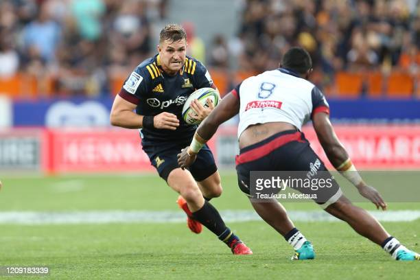 Michael Collins of the Highlanders makes a break during the round five Super Rugby match between the Highlanders and the Rebels at Forsyth Barr...