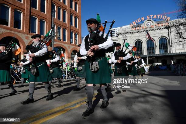 Michael Collins Pipe and Drums head up 17th Ave at the start of the annual St Patrick's parade in downtown Denver March 17 2018