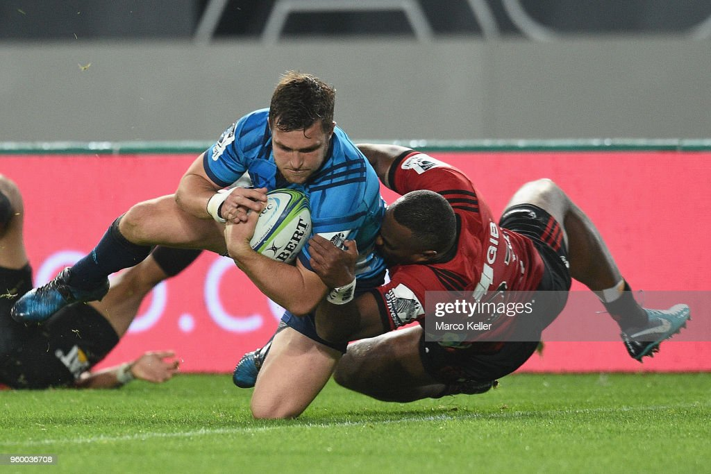 Michael Collins scores a try while being tackled by Manasa Mataele during the round 14 Super Rugby match between the Blues and the Crusaders at Eden Park on May 19, 2018 in Auckland, New Zealand.