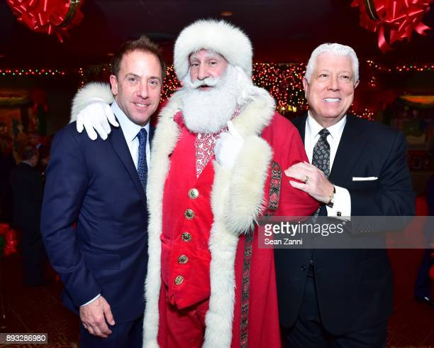 Michael Cominotto Santa Claus and Dennis Basso attend A Christmas Cheer Holiday Party 2017 Hosted by George Farias and Anne and Jay McInerney at The...