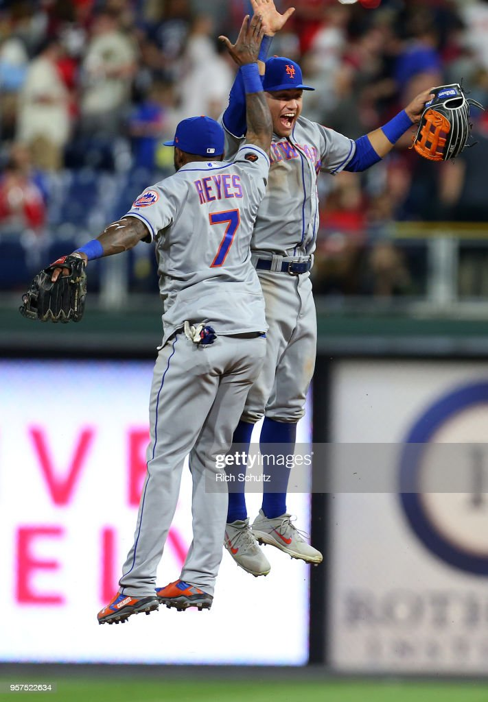 Michael Conforto #30 and Jose Reyes #7 of the New York Mets celebrate after defeating the Philadelphia Phillies 3-1 during a game at Citizens Bank Park on May 11, 2018 in Philadelphia, Pennsylvania.