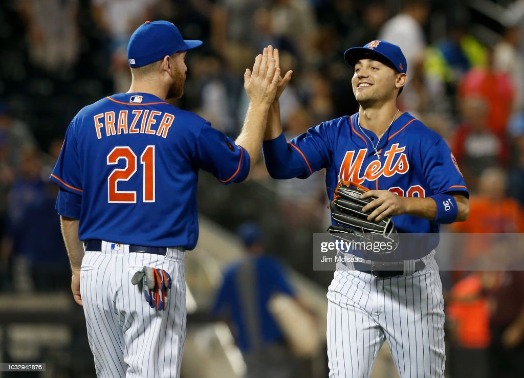 Michael Conforto #30 and Todd Frazier #21 of the New York Mets celebrate after defeating the Miami Marlins in game two of a doubleheader at Citi Field on September 13, 2018 in the Flushing neighborhood of the Queens borough of New York City.