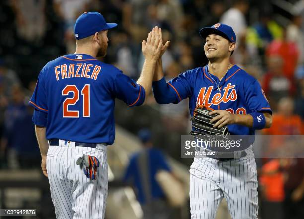 Michael Conforto and Todd Frazier of the New York Mets celebrate after defeating the Miami Marlins in game two of a doubleheader at Citi Field on...
