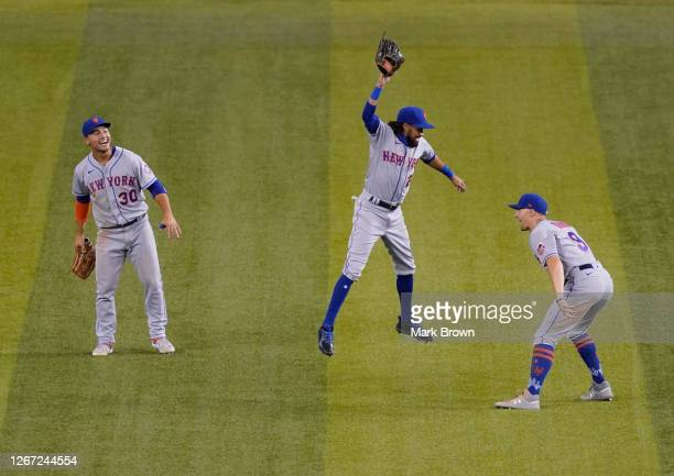 Michael Conforto, Billy Hamilton, and Brandon Nimmo of the New York Mets celebrate the win against the Miami Marlins by score of 5-3 at Marlins Park...