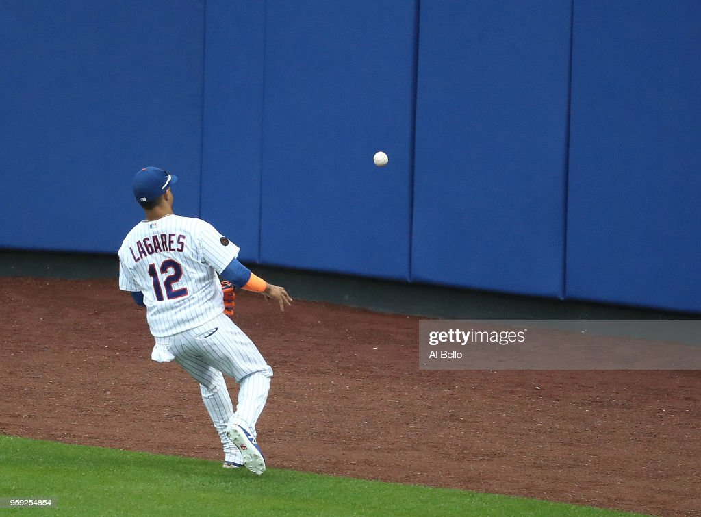 Michael Conforto #30 of the New York Mets cannot get to a double hit by Justin Smoak #14 of the Toronto Blue Jays resulting in a two run double in the sixth inning during their game at Citi Field on May 16, 2018 in New York City.