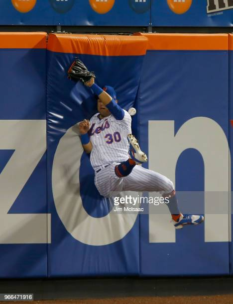 Michael Conforto of the New York Mets can't come up with a ball hit in the seventh inning for a double by Jason Heyward of the Chicago Cubs at Citi...