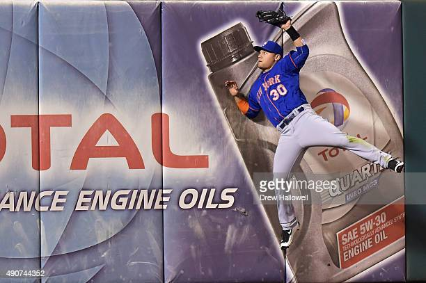 Michael Conforto of the New York Mets catches a fly ball at the wall during the game against the Philadelphia Phillies at Citizens Bank Park on...