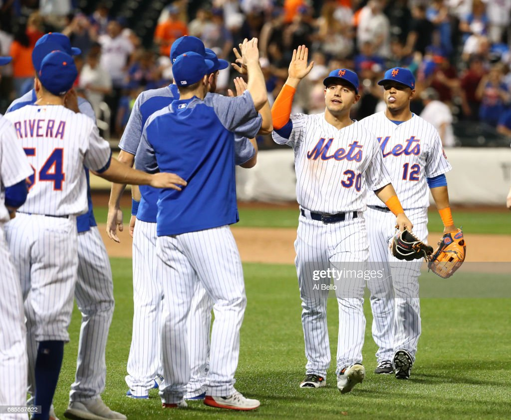 Michael Conforto #30 of the New York Mets celebrates a 3-0 win against the Los Angeles Angels at Citi Field on May 19, 2017 in New York City.