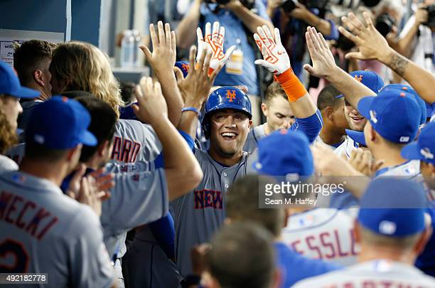 Michael Conforto of the New York Mets celebrates after hitting a solo home run in the second inning against the Los Angeles Dodgers in game two of...