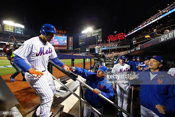 Michael Conforto of the New York Mets celebrates in the dugout after hitting a solo home run in the third inning against the Kansas City Royals...