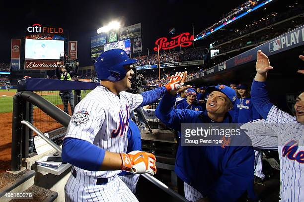 Michael Conforto of the New York Mets celebrates in the dugout after hitting a solo home run in the fifth inning against Danny Duffy of the Kansas...