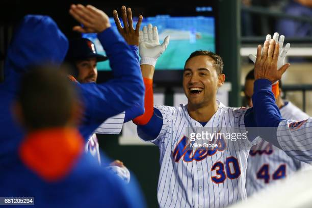 Michael Conforto of the New York Mets celebrates in the dugout after hitting a solo home run in the seventh inning against the San Francisco Giants...