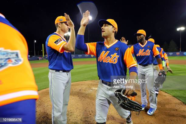 Michael Conforto of the New York Mets celebrates with teammates after the Mets defeated the Philadelphia Phillies in the 2018 Little League Classic...