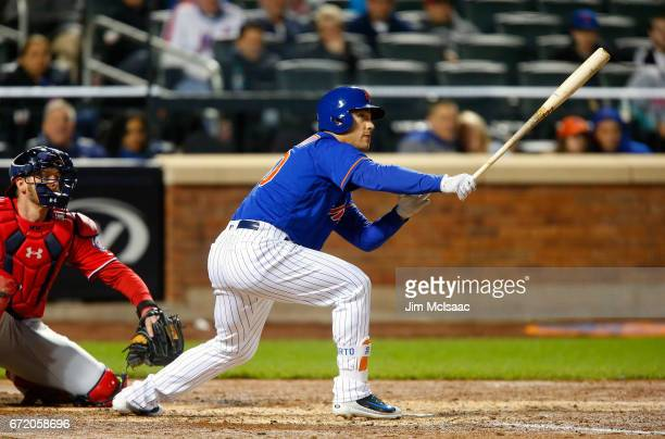 Michael Conforto of the New York Mets follows through on a fifthinning base hit against the Washington Nationals at Citi Field on April 23 2017 in...
