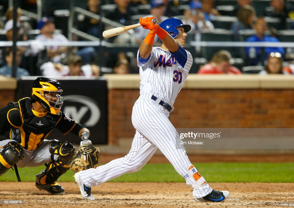 Michael Conforto #30 of the New York Mets follows through on his fifth inning two run home run against the Pittsburgh Pirates at Citi Field on June 2, 2017 in the Flushing neighborhood of the Queens borough of New York City.