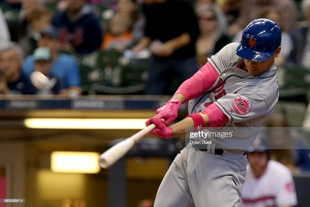 Michael Conforto #30 of the New York Mets hits a home run in the first inning against the Milwaukee Brewers at Miller Park on May 14, 2017 in Milwaukee, Wisconsin. Players are wearing pink to celebrate Mother's Day weekend and support breast cancer awareness.