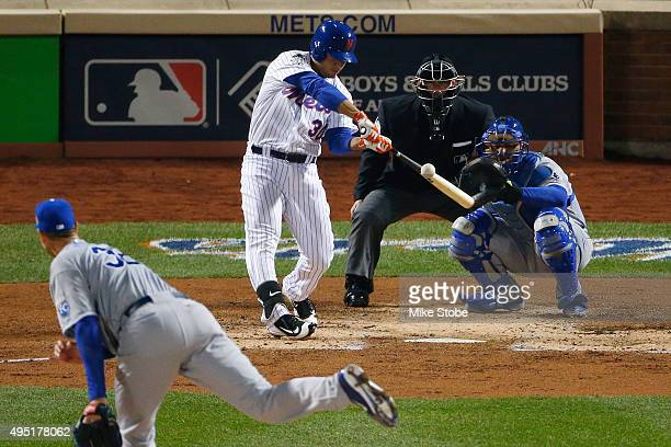Michael Conforto of the New York Mets hits a solo home run in the third inning against Chris Young of the Kansas City Royals during Game Four of the...
