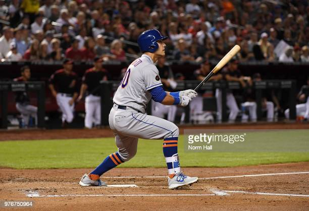 Michael Conforto of the New York Mets hits a three run home run off of Patrick Corbin of the Arizona Diamondbacks during the second inning at Chase...
