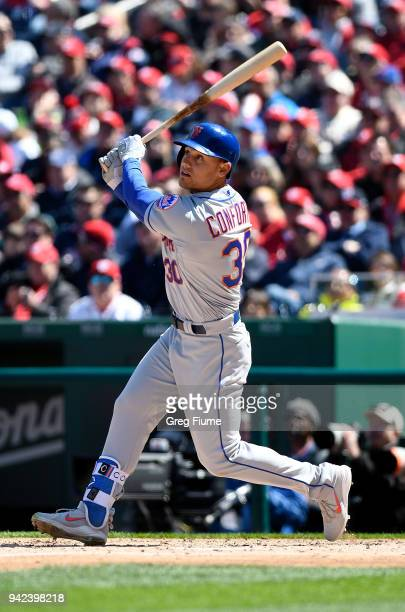 Michael Conforto of the New York Mets hits a tworun home run in the fifth inning against the Washington Nationals during the home opener at Nationals...