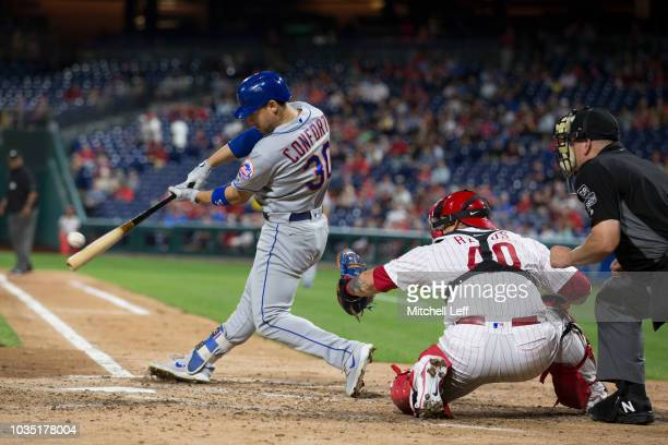 Michael Conforto of the New York Mets hits a three run home run in the top of the ninth inning against the Philadelphia Phillies at Citizens Bank...
