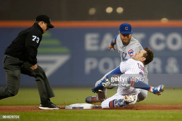 Michael Conforto of the New York Mets is tagged out attempting to stretch a single into a double by Ben Zobrist of the Chicago Cubs in front of...