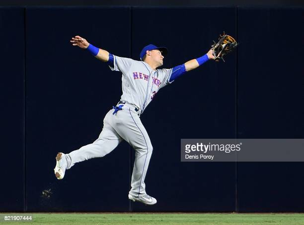 Michael Conforto of the New York Mets makes a leaping catch on a ball hit by Jose Pirela of the San Diego Padres during the sixth inning of a...