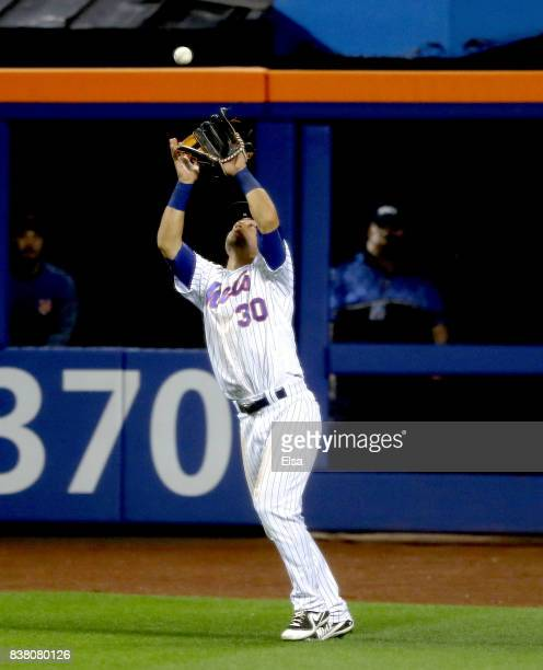 Michael Conforto of the New York Mets makes the catch for the final out of the game against the Arizona Diamondbacks on August 23 2017 at Citi Field...