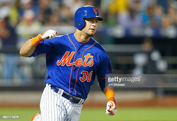 Michael Conforto of the New York Mets reacts after his seventh inning gametying tworun home run against the Pittsburgh Pirates at Citi Field on...