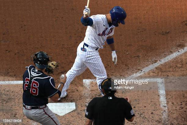 Michael Conforto of the New York Mets reacts after striking out in the third inning against the Atlanta Braves during game one of a doubleheader at...
