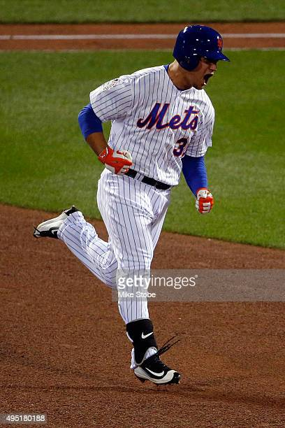 Michael Conforto of the New York Mets rounds the bases after hitting a solo home run in the fifth inning against Danny Duffy of the Kansas City...
