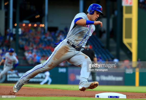 Michael Conforto of the New York Mets rounds third base on his way to score on a RBI single hit by Lucas Duda of the New York Mets against the Texas...
