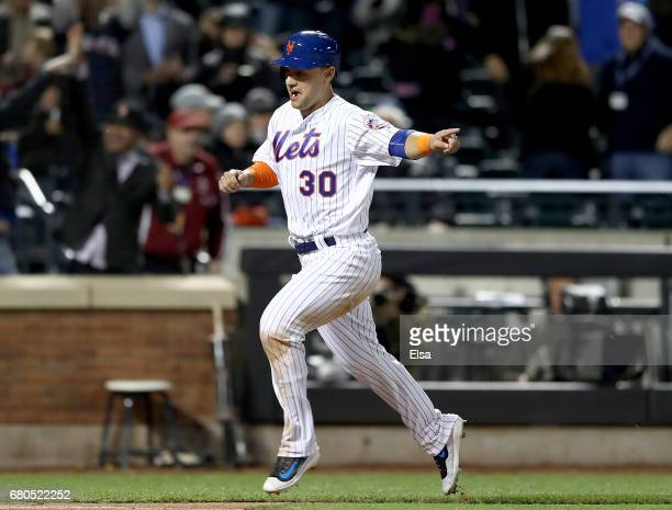 Michael Conforto of the New York Mets score on a hit by teammate Neil Walker to win the game against the San Francisco Giants on May 8 2017 at Citi...