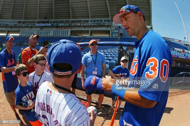 Michael Conforto of the New York Mets signs autographs before a spring training game against the Houston Astros at First Data Field on March 6 2018...
