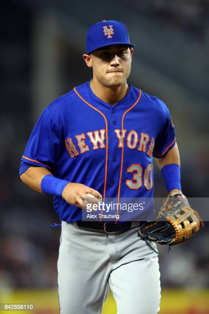 Michael Conforto of the New York Mets walks back to the dugout during the game against the New York Yankees at Yankee Stadium on Monday August 14...