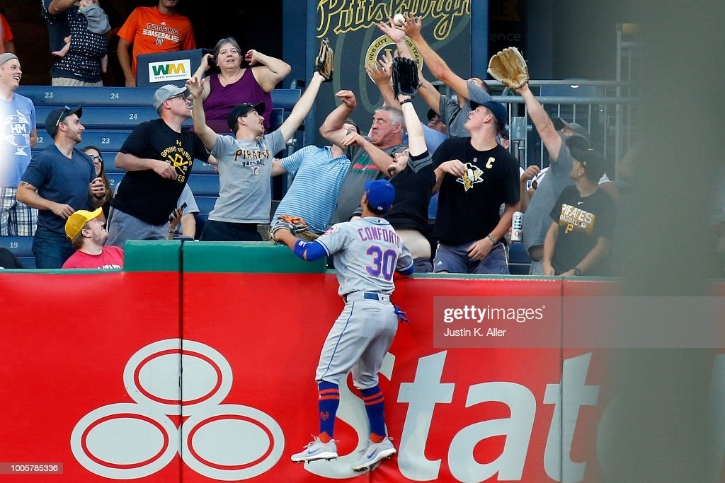 Michael Conforto #30 of the New York Mets watches a home run ball clear the fence in the third inning against the Pittsburgh Pirates at PNC Park on July 26, 2018 in Pittsburgh, Pennsylvania.