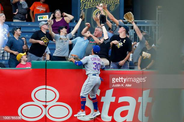 Michael Conforto of the New York Mets watches a home run ball clear the fence in the third inning against the Pittsburgh Pirates at PNC Park on July...