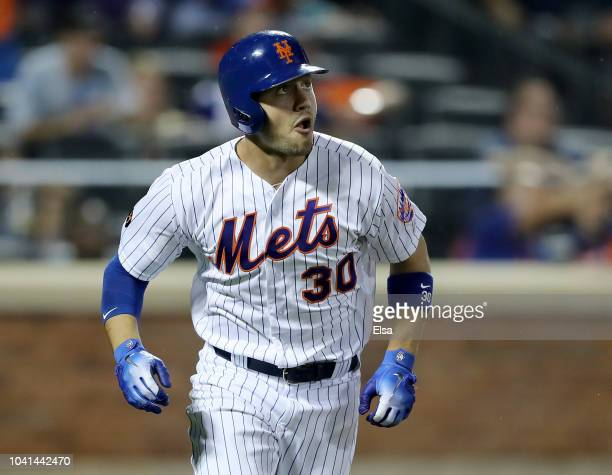Michael Conforto of the New York Mets watches his solo home run in the eighth inning against the Atlanta Braves on September 262018 at Citi Field in...