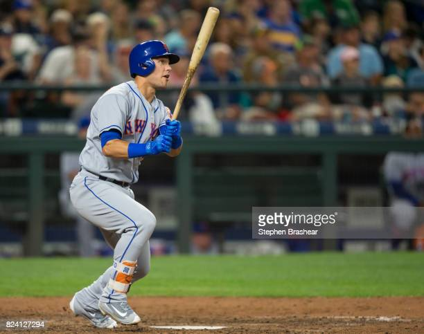 Michael Conforto of the New York Mets watches the ball leave the park after hitting a solo home run off of relief pitcher Marc Rzepczynski of the...