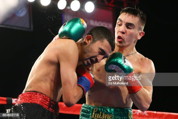 Michael Conlan lands a right hand to the head of Tim Ibarra during their super bantamweight bout at The Theater at Madison Square Garden on March 17...