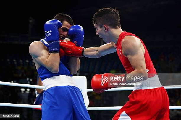 Michael Conlan of Ireland and Aram Avagyan of Armenia compete in the Bantamweight 56 kg Men boxing bout on Day 9 of the Rio 2016 Olympic Games at...