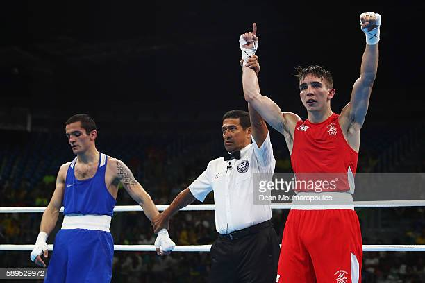 Michael Conlan of Ireland celebrates victory over Aram Avagyan of Armenia after they compete in the Bantamweight 56 kg Men boxing bout on Day 9 of...