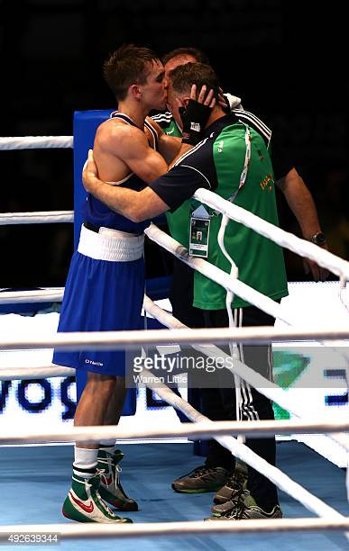 Michael Conlan of Ireland kisses his coach after beating Murodjon Akhmadaliev of Uzbekistan in the final of the Men's Bantam Weight during the AIBA...