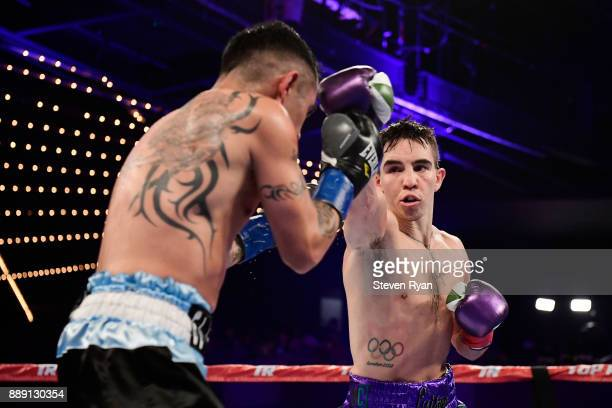 Michael Conlan punches Luis Fernando Molina during their Featherweight bout at Madison Square Garden on December 9 2017 in New York City