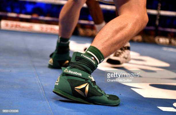 Michael Conlan's boots with the legend 'The Conlan Revolution' stitched into it's ankle section during his bout with Adeilson Dos Santos as part of...